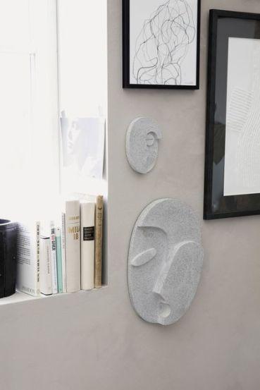 decoration-murale-en-beton-en-forme-de-visage_6111012